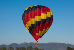 Colored hot hair balloon flying over italian apennines Stock Images