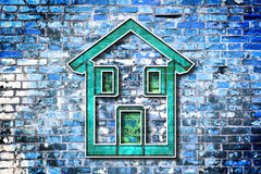 Colored house drawn on a brick wall Royalty Free Stock Image