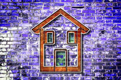 Colored house drawn on a brick wall background Royalty Free Stock Images