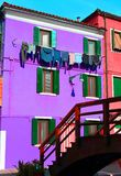 Colored House on the island of Burano with clothes hung out to d Stock Photos