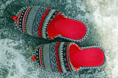 Colored house slippers on ice in the snow Royalty Free Stock Images