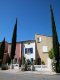 Colored houses. Against blue sky in south of France Stock Image
