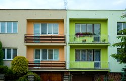 Colored houses. Orange and green duplex Royalty Free Stock Images