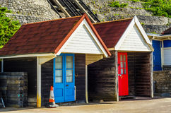 Colored houses on the beach, colorful door to summer cottages, s Royalty Free Stock Photography
