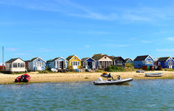 Colored houses on the beach Stock Photos