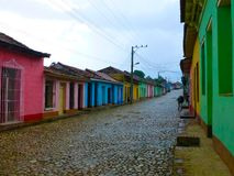 Colored houses on cobble stone street of Trinidad, Cuba stock images