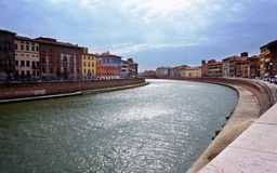Colored houses on embankment of River Arno in Pisa, Tusc Royalty Free Stock Photos