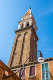 The colored houses near the old leaning Church Tower on Burano i Stock Images