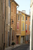 Colored houses in the Provence. Colored houses with plastered facades in Bedoin, France Stock Photo