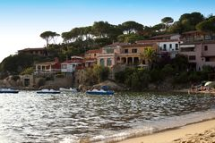 Panorama by Scaglieri beach. On Elba Island, Italy. Colored houses on the rocks. Beautiful seascape of Scaglieri beach. This place is located on Elba Island, in stock photo