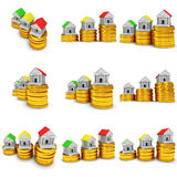 Colored houses on stack of coins set. 3d render. Royalty Free Stock Photo