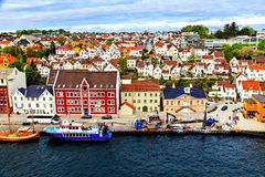 The colored houses, street and boats on water royalty free stock photography