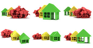 Colored houses in varying phases of destruction Royalty Free Stock Photography