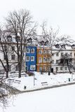Colored houses in warsaw old town after snow storm in winter, colorful exteriors against the white snow.  stock image