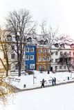 Colored houses in warsaw old town after snow storm in winter, colorful exteriors against the white snow, colored light. Colored houses in warsaw old town after royalty free stock photos