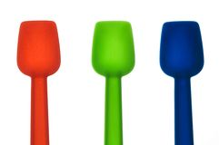 Colored ice cream spoons Royalty Free Stock Image