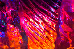 Colored icy surface. Ice is backlit with purple,orange and blue color stock images