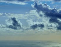 Colored image of clouds and ship on the sea at dawn Royalty Free Stock Photos