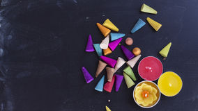Colored incense and candles on chalk board background flat lay Royalty Free Stock Photo