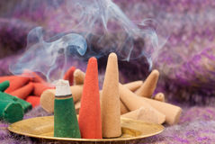 Colored incense cones burning Royalty Free Stock Images