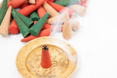 Colored incense cones burning in plate Royalty Free Stock Photography