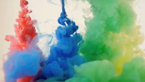 Colored ink explosion on white background.