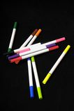 Colored Ink Markers. Some Colored Ink Markers on a Black Background royalty free stock image