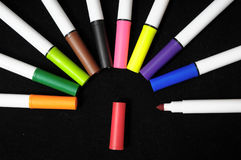 Colored Ink Markers. Some Colored Ink Markers on a Black Background Royalty Free Stock Photos