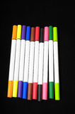Colored Ink Markers. Some Colored Ink Markers on a Black Background royalty free stock images