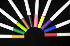 Colored Ink Markers. Some Colored Ink Markers on a Black Background stock image