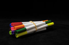 Colored Ink Markers. Some Colored Ink Markers on a Black Background royalty free stock photography