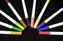 Colored Ink Markers. Some Colored Ink Markers on a Black Background Stock Photo