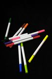 Colored Ink Markers. Some Colored Ink Markers on a Black Background Royalty Free Stock Photo