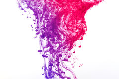 Colored ink splash royalty free stock photography
