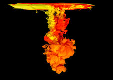 Colored ink in water creating abstract shape Royalty Free Stock Photo