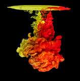 Colored ink in water creating abstract shape Stock Photos