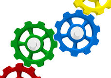 Colored interlocking gears. Colorful illustration of a series of interlocking gears or cogs royalty free illustration