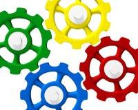 Colored interlocking gears. Illustration of four colorful interlocking gears or cogwheels.  White background Royalty Free Stock Photos