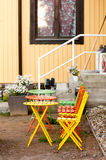 Colored iron chairs and a table Royalty Free Stock Images