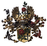 Colored iron coat of arms isolated against white background.  Stock Image