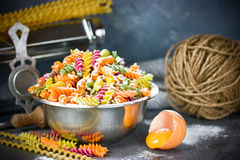 Colored italian fusilli pasta , process of cooking homemade past. A with natural dyes Royalty Free Stock Photos