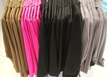 Colored jackets. On hangers in a store Stock Photos