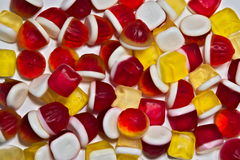 Colored jelly beans scattered on a white background. Jelly beans arranged as a background Stock Photos