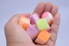 Colored Jelly Sweets in hand. Colored Jelly Sweets for a fruit dessert Royalty Free Stock Photo