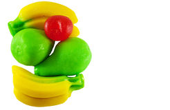 Colored jellys. Colored jelly candies in the shape of fruits banana pear isolated on a white background Royalty Free Stock Images