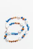 Colored jewelery. Diverse type of hand made colored jewelery Stock Photo