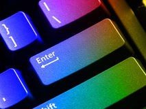 Colored keyboard. Showing diversity of the IT domain. Also, diversity of communication means and languages. The Enter key is also useful for Admission Royalty Free Stock Photography