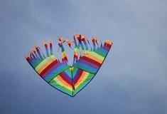 Colored kite in the sky Stock Photo