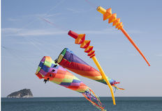 Colored kites in a windy day in ligurian riviera, italy Stock Photography