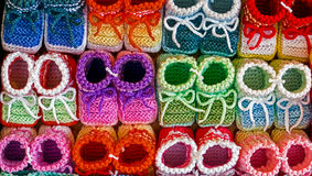 Colored knitted booties for newborns Stock Photo